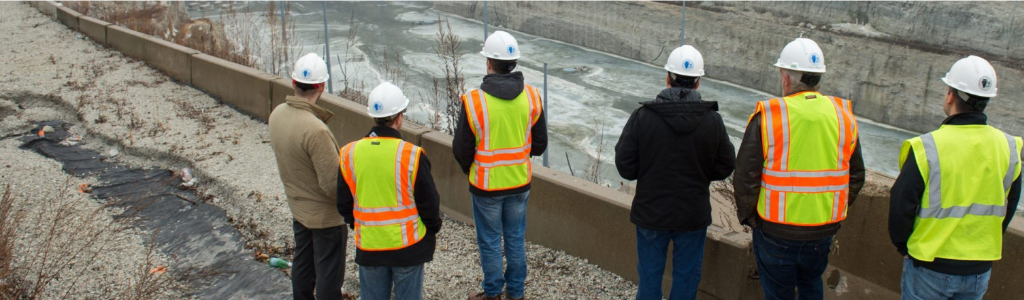 Construction workers looking at a reservoir